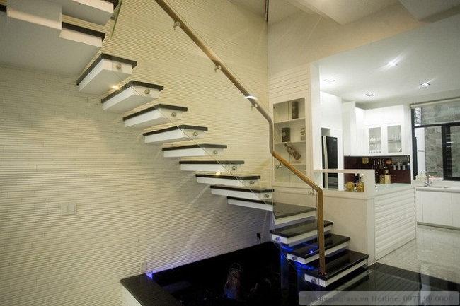 Lan can cầu thang kính sử dụng pad đơn đẹp hiện đại
